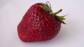 Fresh Strawberry In Rotation, Isolated, White Background stock footage