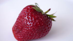 Fresh  Strawberry In Rotation, Isolated, White Background. Indoor stock footage