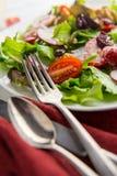 Fresh Strawberry Salad. Fresh organic romaine lettuce salad with walnuts radishes and strawberries Royalty Free Stock Photo