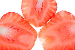 Fresh strawberry slices isolated on white background, close up Royalty Free Stock Photography
