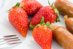 Fresh strawberry with smoked sausage Royalty Free Stock Photos