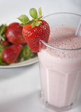Fresh strawberry smoothie drink. With fresh strawberries in background Royalty Free Stock Photos