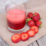 Fresh strawberry smoothie juice and strawberries Royalty Free Stock Image