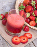 Fresh strawberry smoothie juice and strawberries Stock Photos