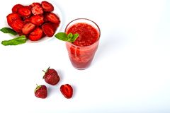 Fresh strawberry smoothie, summer drink, healthy antioxidant juice with vitamin from ripe fruits.  royalty free stock photography