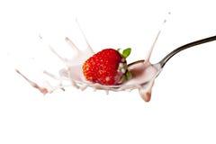 Fresh strawberry splashing into the spoon Royalty Free Stock Image