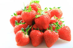 Fresh strawberry, sweet fruits, on the white plastic chopping board. Royalty Free Stock Photography