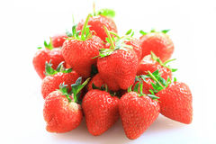 Fresh strawberry, sweet fruits, on the white plastic chopping board. Stock Photos