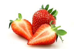 Fresh strawberry and two halves. Isolated on white royalty free stock photos