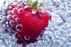 Fresh strawberry in water stock photo