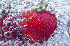 Fresh strawberry in water Stock Photos