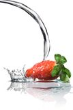 Fresh strawberry and water. Splash isolated on white Royalty Free Stock Photos