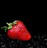 Fresh strawberry with water drops on black Royalty Free Stock Photos