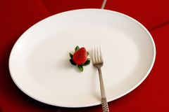 Fresh Strawberry on white plate with fork and red. A Fresh Australian Strawberry on a White Plate with Fork Stock Image