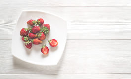 Fresh strawberry on a white wooden boards Royalty Free Stock Photography