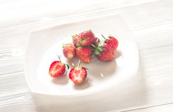 Fresh strawberry on a white wooden boards Royalty Free Stock Image