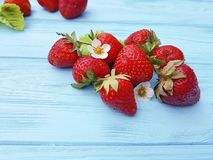 Fresh organic strawberry healthy fruit farming summer harvest on a blue wooden background. Fresh strawberry whole organic blue wooden background healthy harvest stock images