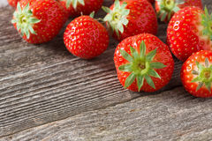 Fresh strawberry on a wooden background, horizontal Royalty Free Stock Photo