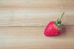 Fresh strawberry on wooden background Royalty Free Stock Photos