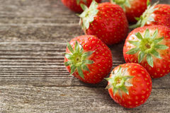 Fresh strawberry on a wooden background, selective focus Stock Photos