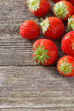 Fresh strawberry on a wooden background, vertical Royalty Free Stock Photography