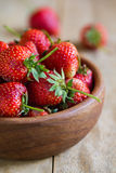 Fresh Strawberry in a wooden bowl Stock Image