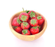Fresh strawberry in a wooden bowl isolated on white background. Fresh strawberry in a wooden bowl Royalty Free Stock Images