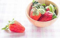 Fresh strawberry on wooden bowl Stock Photo