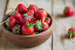 Fresh Strawberry in a wooden bowl Royalty Free Stock Photos