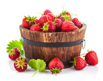 Fresh strawberry in wooden bucket with green leaf Stock Photography