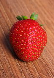 Fresh strawberry on wooden table Royalty Free Stock Photos