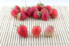 Fresh strawberry on wooden weave Stock Images