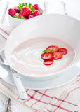 Fresh strawberry yoghurt in a bowl. With fresh berries Royalty Free Stock Images