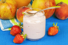 Fresh strawberry yogurt with fruits around on the table Royalty Free Stock Image