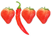 Fresh strawberryes and red chili-pepper Royalty Free Stock Photography