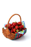 Fresh strawberrys. Basket with fresh strawberries on a multicolored napkin Stock Photos