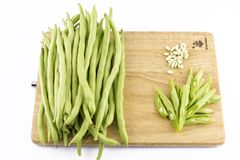 Fresh string beans. Is decorated on a cutting boards, They are isolated on a white background stock images