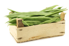Fresh string beans in a wooden crate Stock Images