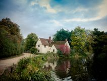 Fresh Stunning Autumn English Country Mill Cottage House. Willy`s lott`s famous old white cottage house in flatford suffolk Stock Photo