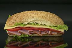 fresh submarine sandwich with ham, cheese, tomatoes, lettuce Royalty Free Stock Image