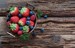 Fresh summer berries in bowl. Summer berries in bowl on wooden table, strawberry, raspberry and blueberry Stock Photos