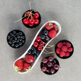 Fresh summer berries in bowls. Top view. Royalty Free Stock Photo