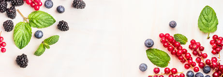 Fresh summer berries, corner frames on white wooden background, top view, banner for website Royalty Free Stock Photos