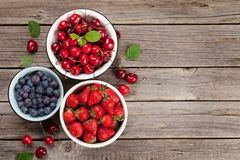 Fresh summer berries. Cherry, blueberry and strawberry. Top view with space for your text stock images