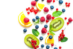 Fresh summer berries and fruits on white royalty free stock photography