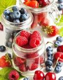 Summer berries in glass jar. Fresh summer berries in glass jar Royalty Free Stock Photo