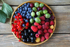 Fresh summer berries on plate Royalty Free Stock Images