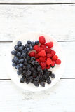 Fresh summer berries on a plate Stock Photo