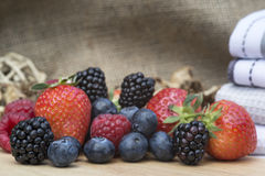 Fresh Summer berries in rustic kitchen setting Stock Photos