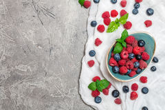 Fresh summer berries in vintage bowl Royalty Free Stock Photo